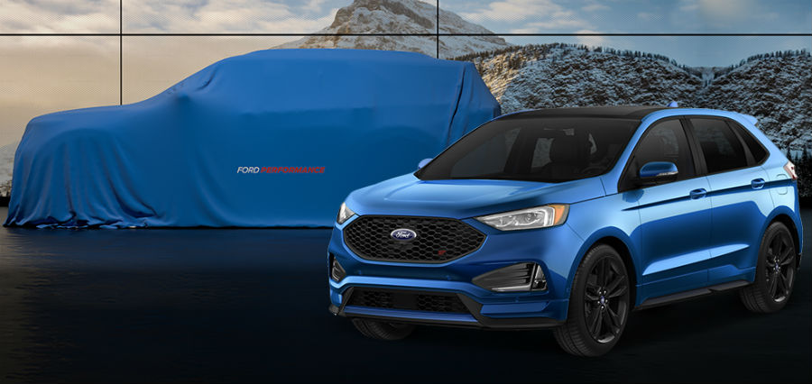 side view of a blue 2019 Ford Edge ST with a covered all-new Ford Explorer ST in the back