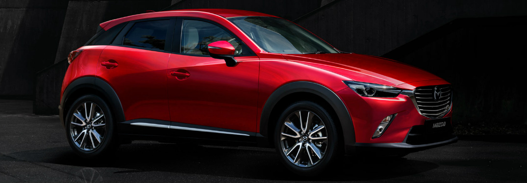 red 2018 Mazda CX-3 parked in dark room exterior passenger side view