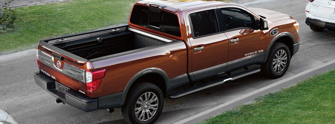 2017 nissan titan xd platinum side view copper
