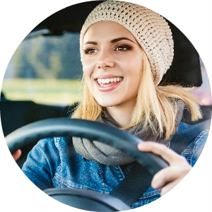 woman happily driving