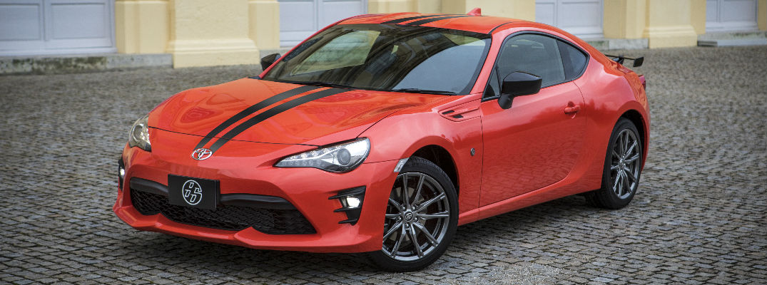 Supernova Orange 2017 Toyota 860 Special Edition Exterior with black Stripes on Cobblestone Road
