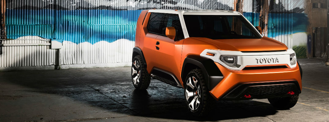 Orange and White Toyota FT-4X Concept in front of beach mural