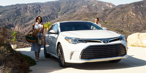 Couple getting into the 2017 Toyota Avalon Hybrid