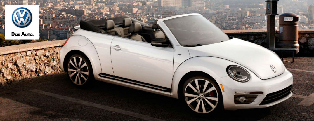 2015 Volkswagen Beetle Convertible with top down. It features the Volkswagen Rollover Protection System.