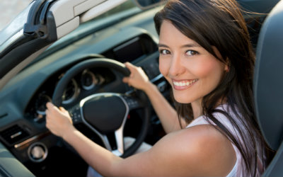 Woman smiling in a rental car