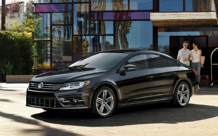 vw cc in black with husband and wife