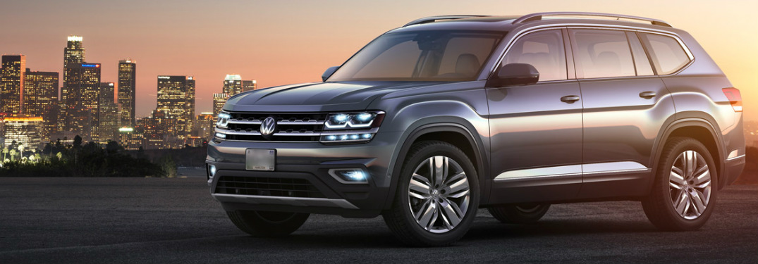 2018 VW Atlas exterior front with city skyline behind it