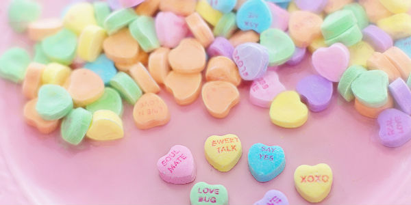 Candy Hearts on Pink Background