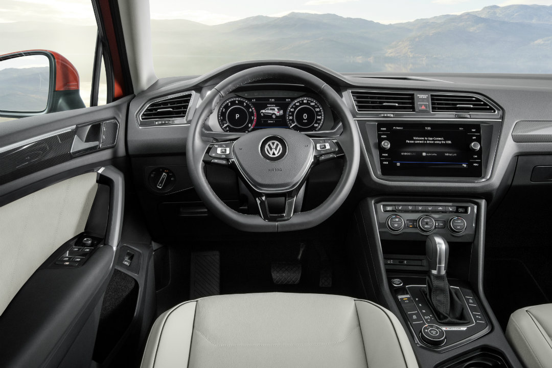 2018 VW Tiguan dash view with steering wheel and infotainment system