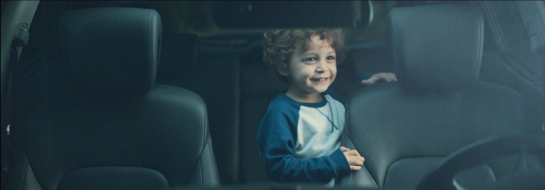 Child in the back seat of a Hyundai