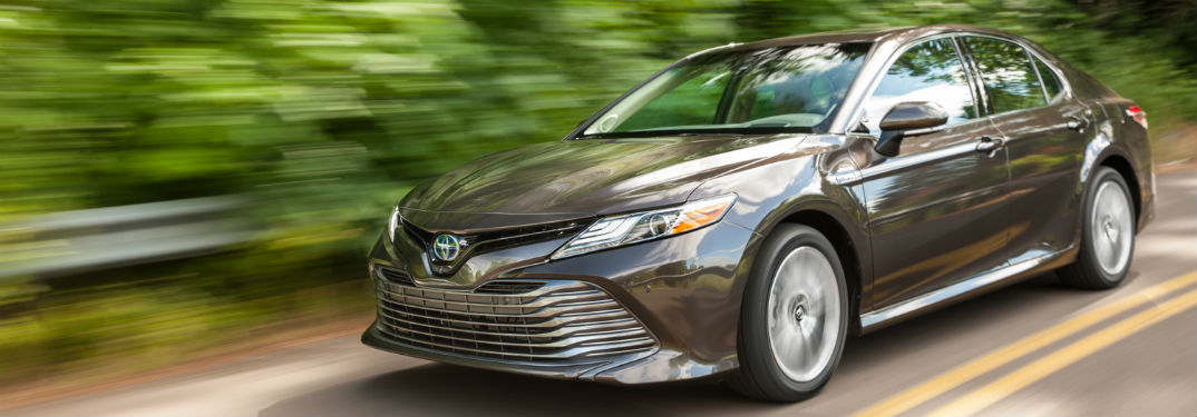 How efficient is the 2018 Toyota Camry Hybrid model?