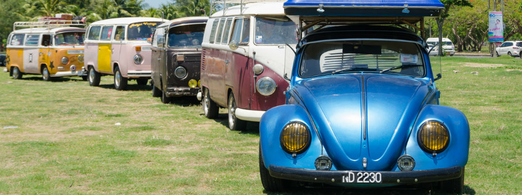 Line of Vintage Volkswagen cars with blue Beetle in foreground