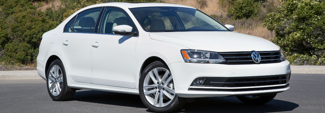 passenger side exterior view of a white 2017 VW Jetta
