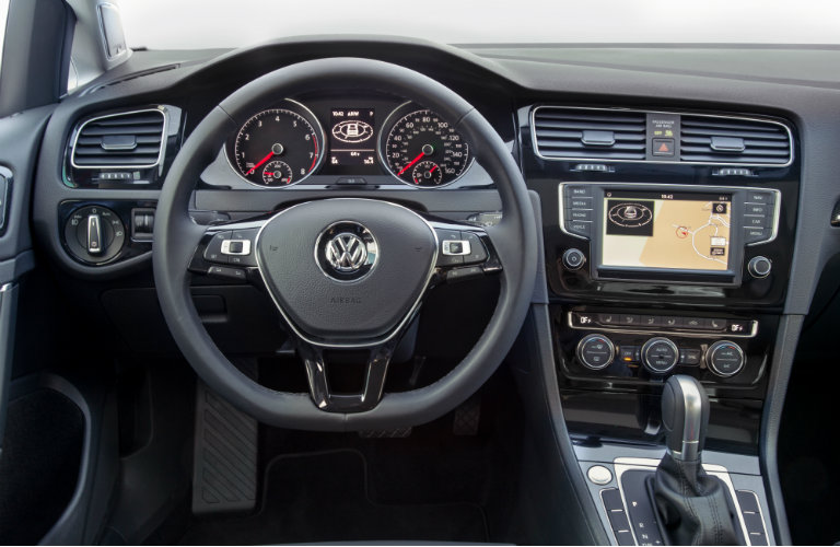 Front Dash Of 2017 VW Golf With Steering Wheel And VW Car Net App