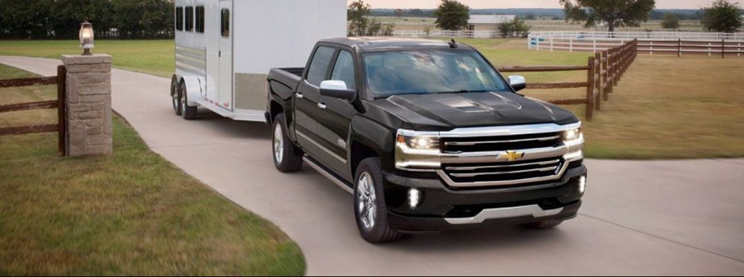 2017 Chevy Silverado 1500 exterior front towing a trailer
