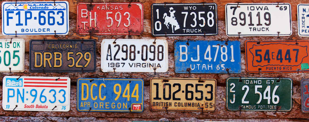 colorful old license plates from many states against a brown background  sc 1 st  Broadway Auto Credit & How Can I Get Collector Plates in Wisconsin?