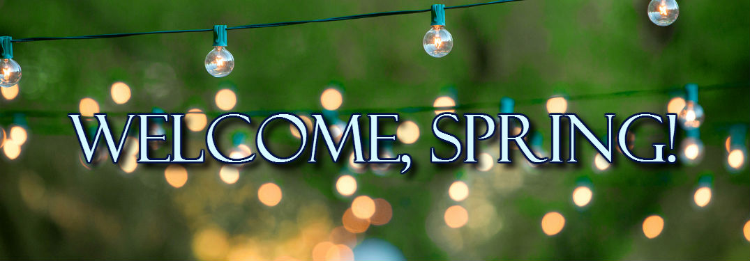 Welcome spring text on lit background