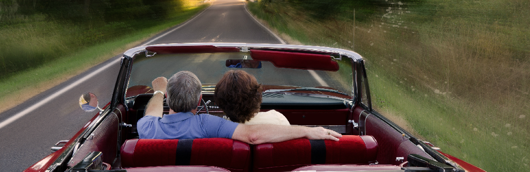 Couple Driving a Convertible
