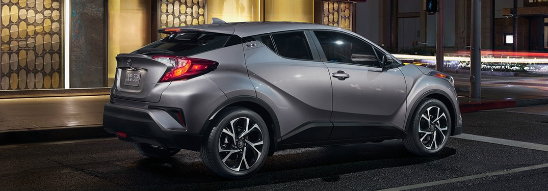 2018 Toyota C-HR on street at night exterior rear side view
