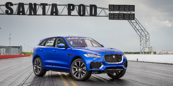 Blue 2017 Jaguar F-PACE on the track at Goodwood Speed Festival