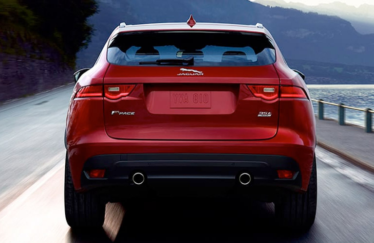 Red 2018 jaguar F-PACE Rear Exterior on Highway Next to Water