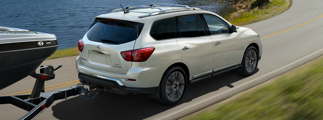 2017 Nissan Pathfinder towing a boat