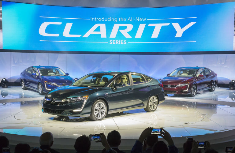 Honda Clarity models on stage