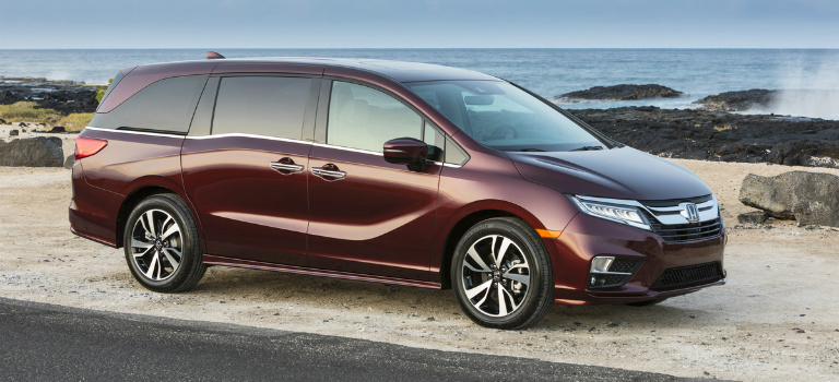 2018 Honda Odyssey red at the beach