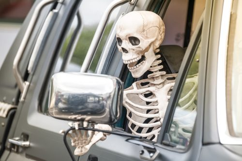 Skeleton driving a truck