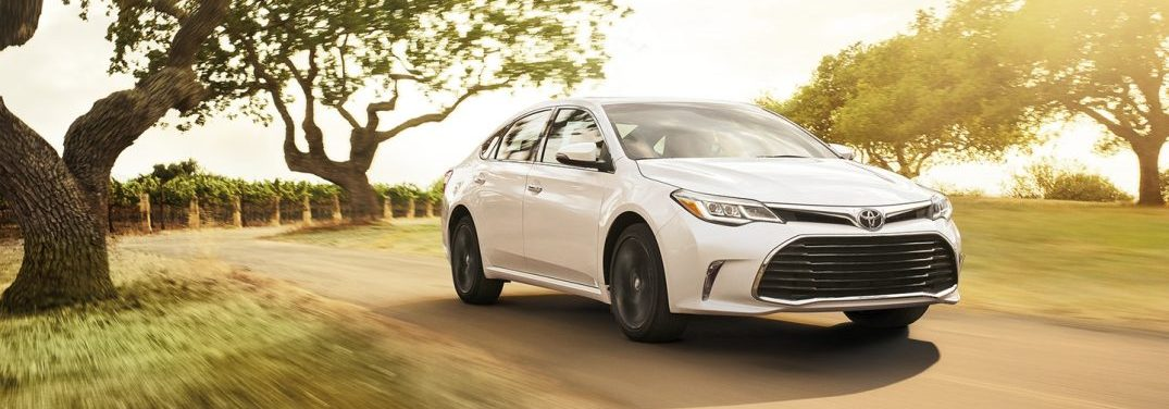 2018 Toyota Avalon on dirt road with trees in background