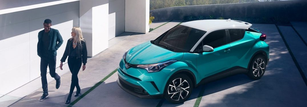 2018 Toyota C-HR in Radiant Green Mica R-Code with two young people walking away