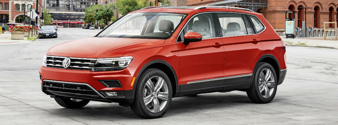 Red 2018 Volkswagen Tiguan Front and Side Exterior Parked in City Square