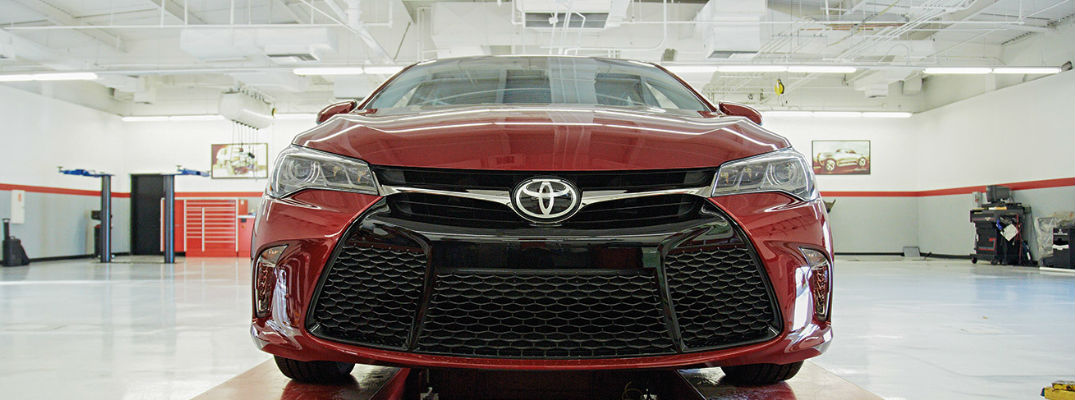 Red Toyota Camry Frotn Exterior Parked in Service Garage