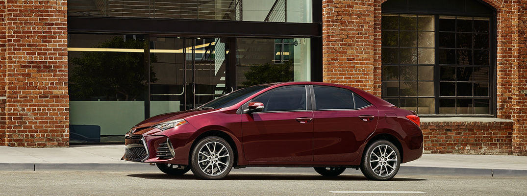 Black Cherry pearl 2017 Toyota Corolla 50th Anniversary Special Edition Next to brick building
