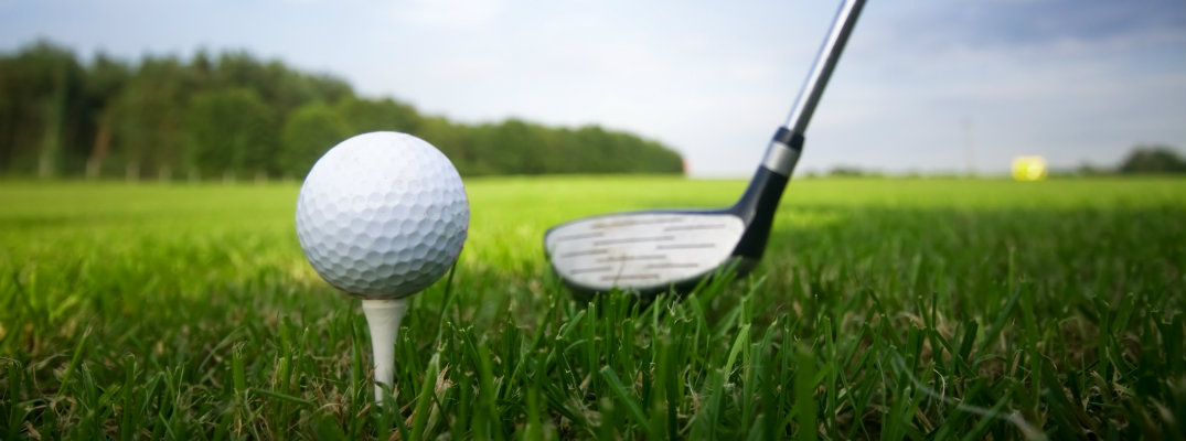 Golf Ball and Club in front of greens - Best Golf Courses near Northern Las Vegas