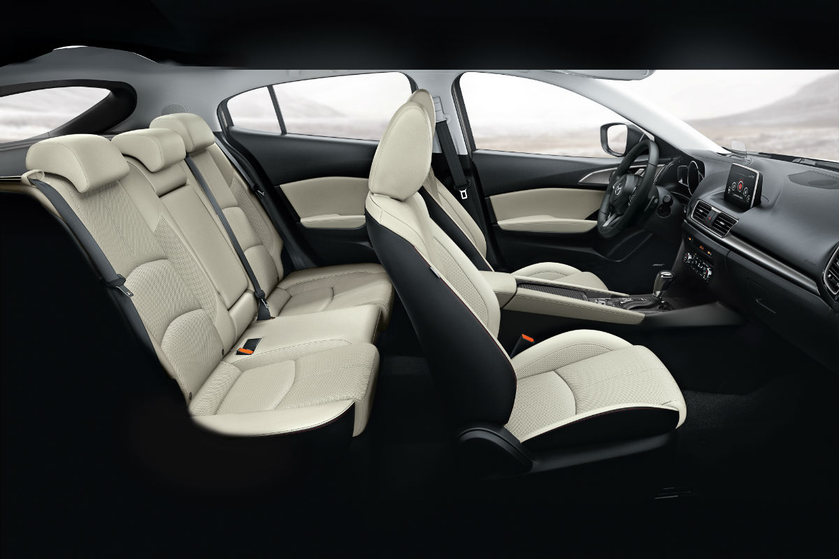 Side view of both interior orws of seats of the 2018 Mazda3