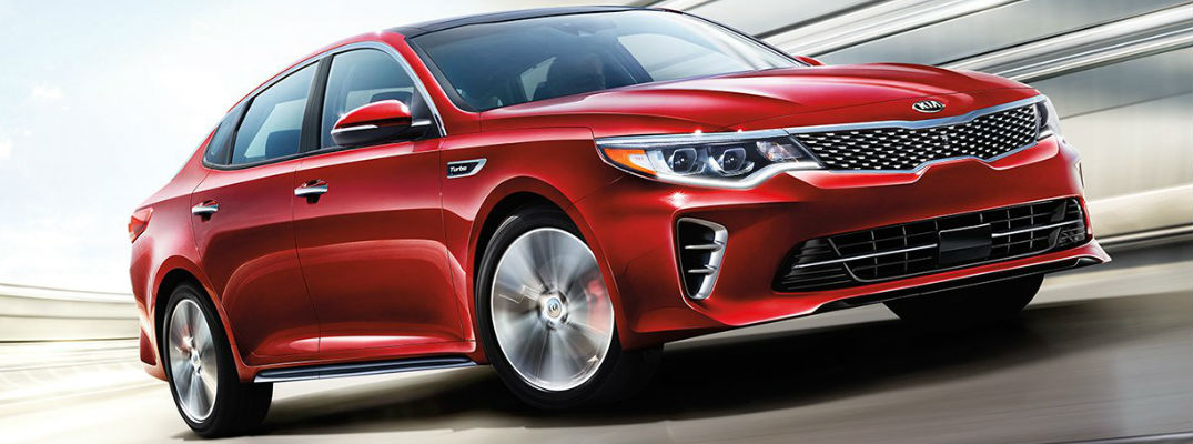 Red 2017 Kia Optima in Motion on Highway