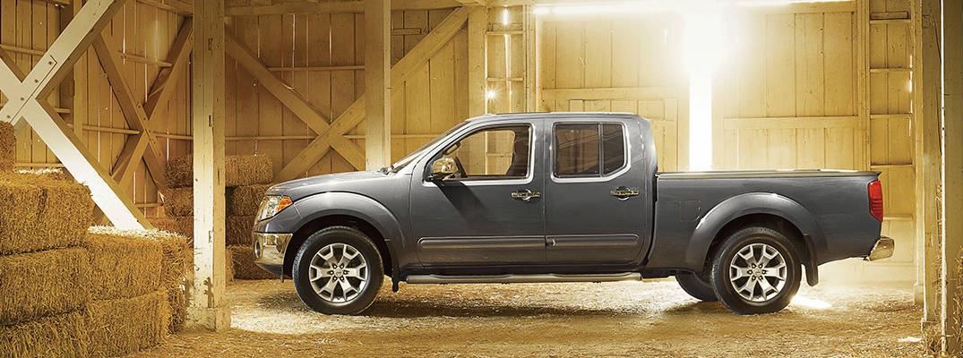 Gray 2017 Nissan Frontier Side Exterior in barn