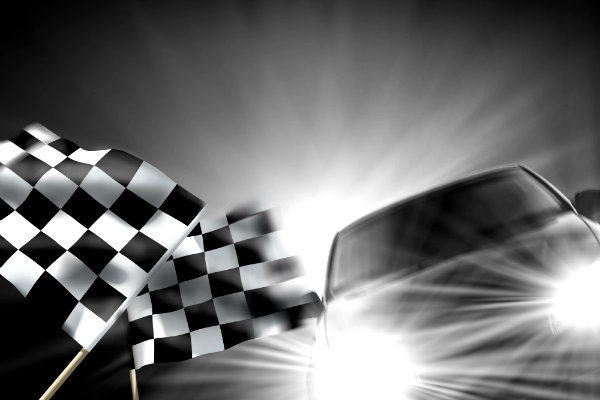Race car with checkered flag waving