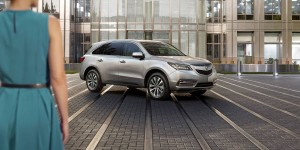 2016-mdx-exterior-with-technology-package-in-lunar-silver-metallic-beige-building-2
