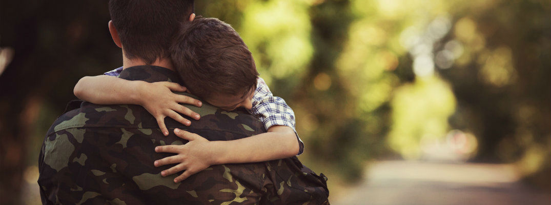 Soldier Hugging Young Boy