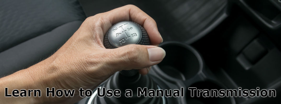 Man with Hand on Manual Transmission Stick Shift