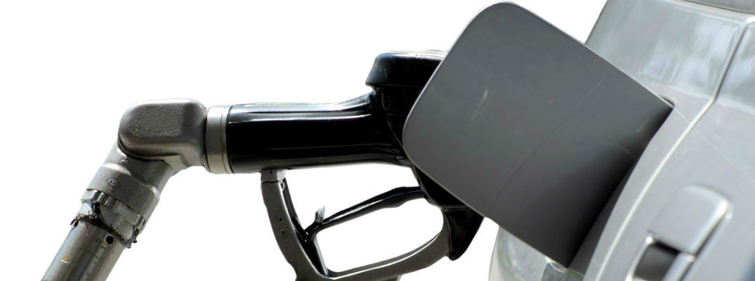 Black Fuel Pump and Silver Car on white background