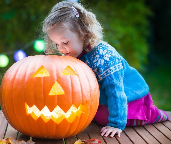Child with a Halloween Pumpkin