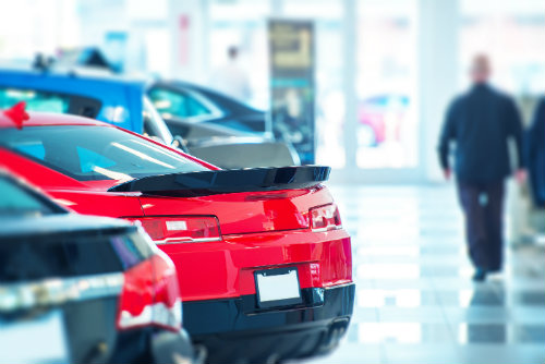 rear view of cars in a dealership showroom
