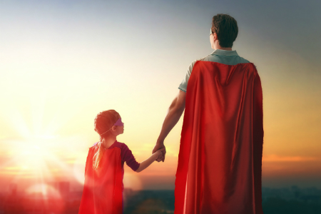 Father and daughter dressed as superheroes