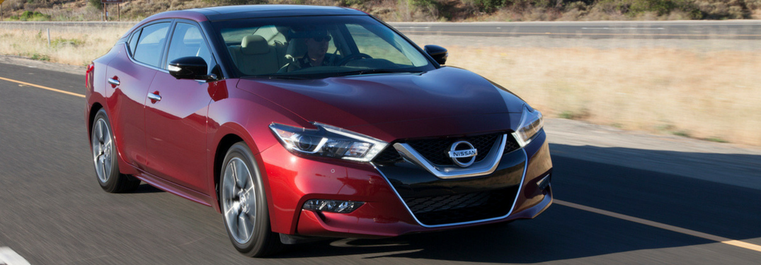 2018 Nissan Altima in red drives down road