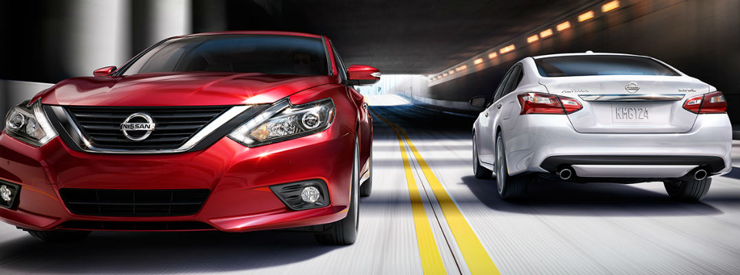 Red and White 2017 Nissan Altima Models Drive Through a Tunnel