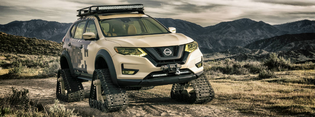 Camouflaged Nissan Rogue Trail Warrior with tracks in desert climate