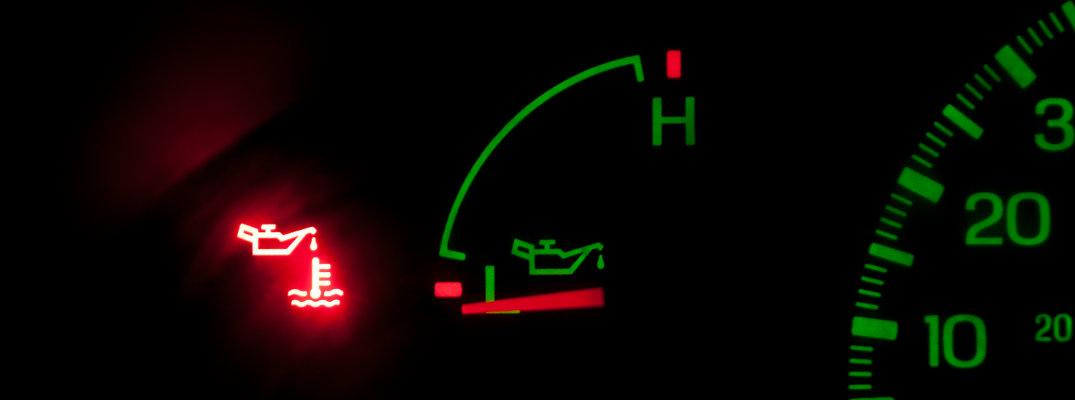lit up oil warning light on a dashboard